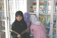 Sharing new books at the Resource Centre