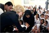 Governor-General handing books to the students