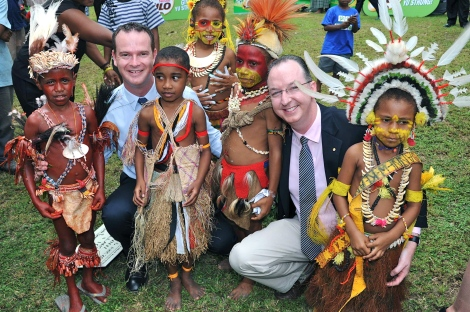 Paul Singer and Mark Fraser with children in Papua New Guinea.