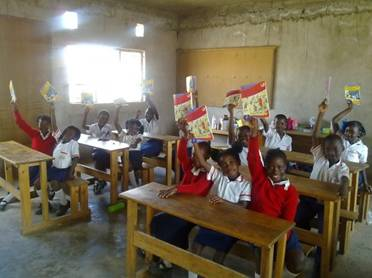 Children with MAMA funded textbooks at Sishemo Education Trust in Zambia.