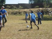 Trying out the new soccer gear. For some of these children, it was the first time they had played on grass.