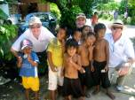 Mark, Paul and John with the children on Bikenibeu village