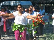 The AMAK women perform a traditional garlanding ceremony