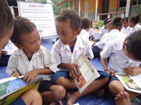 Children in Timor Leste enjoying the new books from the MAMA Mobile Library.