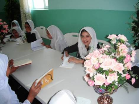 Girls reading books at the new MAMA Resource Centre in the Panjshir Valley, Afghanistan.