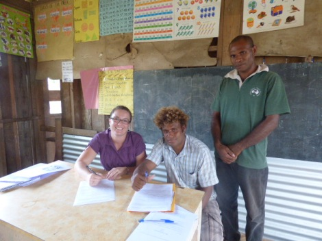 Signing the Building Contract. (L to R: Leigh Pirie, Patteson Amos and Acting Head Teacher, James Qwauna)