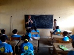 Paul Singer enjoying some time in the classroom with the children in Soibada.