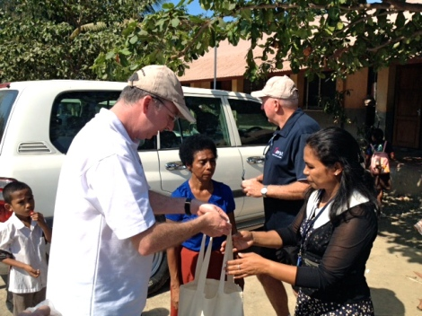 Mark Fraser handing over a sample of the art and craft supplies donated by MAMA to the Alola Foundation.