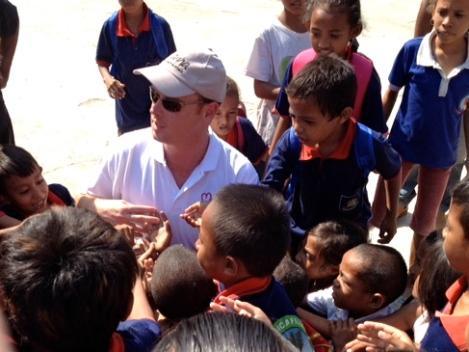 Paul Singer with the children at Tuana Laran School.