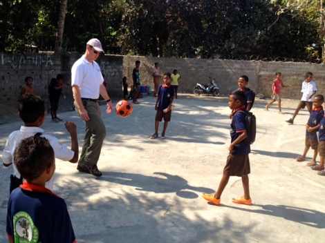 Paul Singer enjoys a game of soccer with the children at Tuana Laran School.