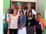 The MAMA Team and Alola Foundation staff at the Alola Headquarters. (Rear left to right: Phil Singer, John Fraser, Mark Fraser (CEO), Paul Singer (General Manager); Front left to right: Kirsty Sword Gusmao (Chair), Alzira Reis (CEO), Ema de Sousa (Education and Literacy Program Manager))
