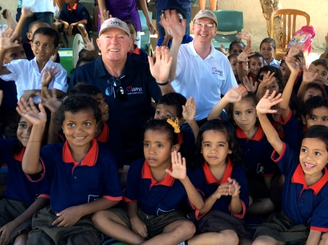 John Fraser and Mark Fraser with the children of Tuana Laran School at the MAMA Mobile Library.
