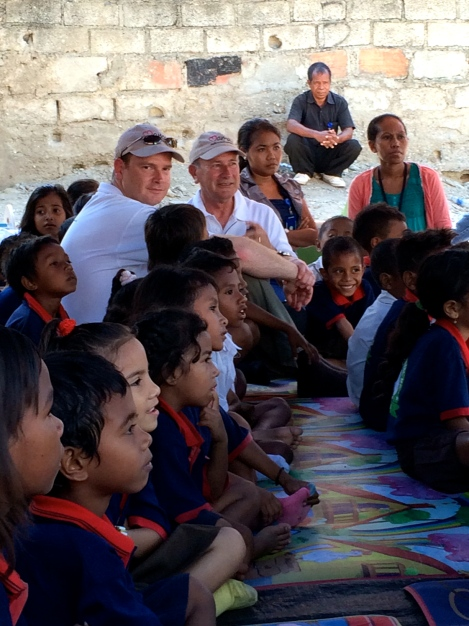 Paul Singer and Phil Singer with the children of Tuana Laran School at the MAMA Mobile Library.