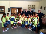 John Fraser, Mark Fraser, Paul Singer and Phil Singer with the girls at the school in Salau, with their equipment donated by the National Convention Centre.